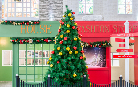 Shenzhen China, November 29th 2015: Green Christmas fir tree with decorative baubles Editorial