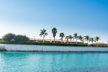 Luxury villa with palm trees in the resort of Jeddah Corniche, 30 km coastal resort area of Jeddah city with coastal road, recreation areas, pavilions Stock Photo