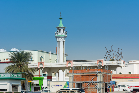 Street view of the city of Jeddah, Kingdom of Saudi Arabia with background of Muslim mosque