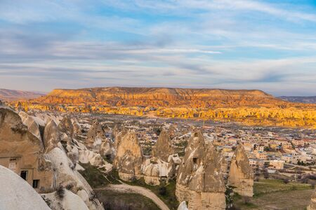 Red Valley and Rose Valley and downtown of Goreme under the twilight  in the evening Cappadocia, Turkey. Stock Photo