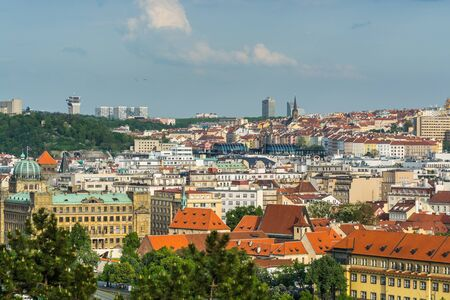 Aerial view of citycape of old town of Prague, with a lot of  rooftops, churches, and the landmarks. view from the Letna park.