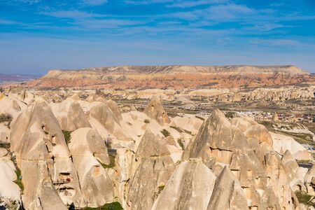 Red Valley and Rose Valley under the sunlight in daytime in Cappadocia, Turkey. Red Valley and Rose Valley Cappadocia get their name from the pinkish red-coloured rock that varies throughout different times of the day