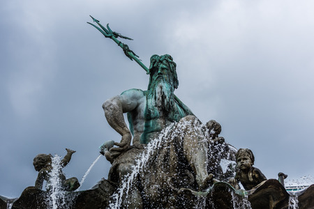 Statue of Neptune Fountain, one of the most iconic fountains of Berlin, Germany. Located on Alexanderplatz beside St Marys Church and Berlins Town Hall