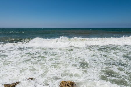 Water flowing and waves in the Mediterranean sea and blue sky at the Tel Aviv port, Israel Reklamní fotografie