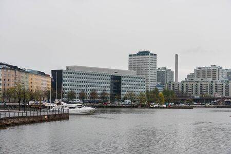 Modern hotels and skylines in harbor of Helsinki, Findland in a rainy day.