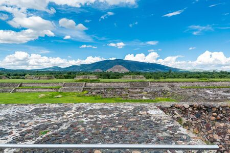 Ruins of the architecturally significant Mesoamerican pyramids with Pyramid of the Sun, the largest building in Teotihuacan, an ancient Mesoamerican city located in a sub-valley of the Valley of Mexico