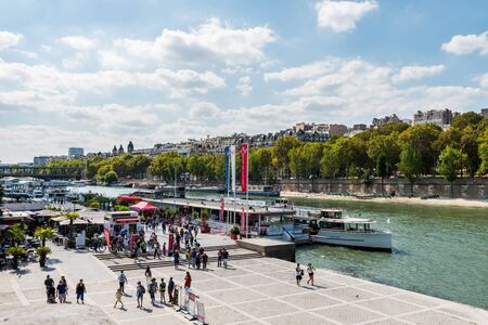 A deck at the bank of  Seine river, view from Pont Alexander III bridge, Paris, France. Editorial