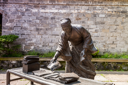 Statue of scholar in the Tianyige Library which is also called Building of Treasured Books, was built in Ming Dynasty, the earliest private library still in existence in China.