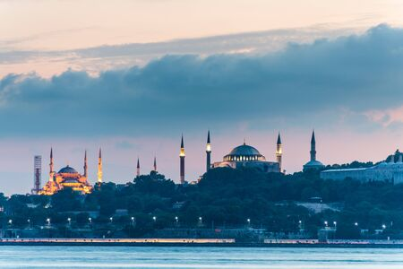 Beautiful night view of Bosphorus strait with Sultan Ahmed Mosque (blue mosque) and Hagia Sophia