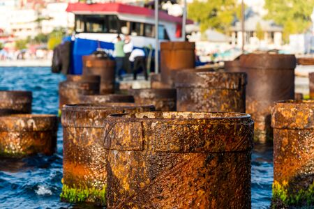 Rusty Steel Pipe berth for boats Coming From Out Of Sea at the Uskudar Istanbul, Turkey, on the Anatolian shore of the Bosphorus.