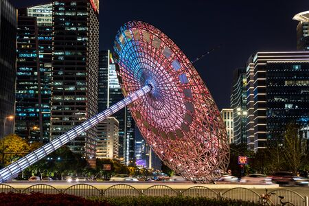 Night view of modern skylines and lankmark statue at the century square in the Pudong, Shanghai, China.