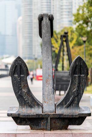 A iron anchor at the bank of Huangpu river, the bund of Shanghai, China.