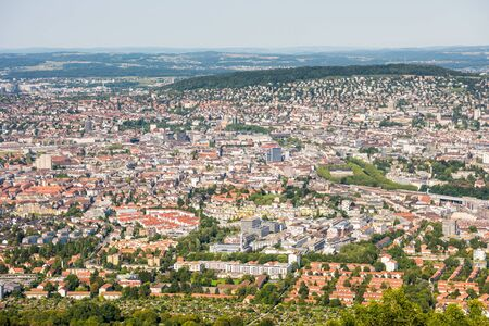 Panoramaof old downtown of Zurich city, with beautiful house at the bank of Limmat River, aerial view from the top of Mount Uetliberg