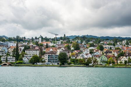 Beautiful buildings on the hills and on the lakeshore of Lake of Zurich, Switzerland.