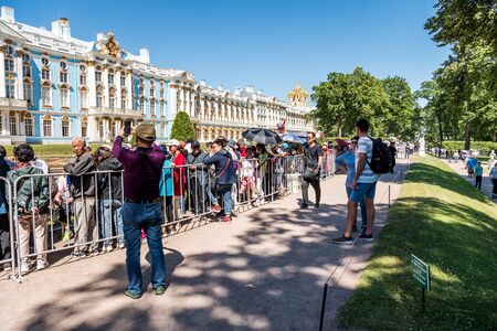 Lots of tourists in the Catherine Palace, a Rococo palace, the summer residence of the Russian tsars. St. Petersburg, Russia