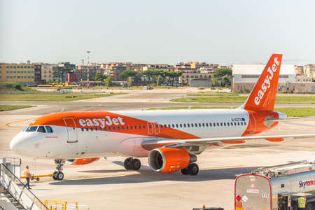 Aircraft of the EasyJet stopped at the apron of Naples international airport Capodichino, Italy