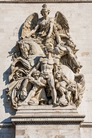 Statue on the wall of the Arc de Triomphe at the Champs-Elysees Avenue in Paris,