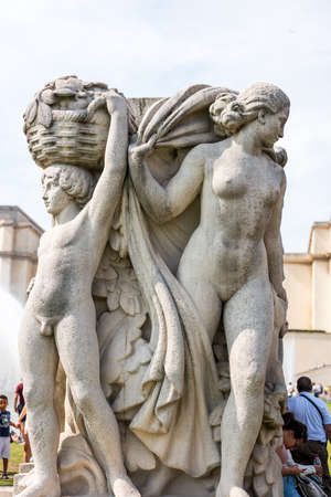 Statue next to the fountain in front of the Palais de Chaillot, a building at the top of the Chaillot hill in the Trocadero area in the 16th arrondissement of Paris, France.