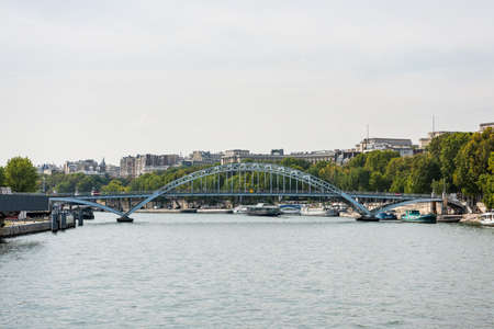 Beutiful historic buildings and bridge across the Seine River, Paris, France. Redactioneel