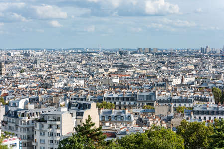 Aerial view of the old town of Paris, view from the The Basilica of the Sacred Heart of Paris, at the summit of the butte Montmartre, the highest point in Paris, France