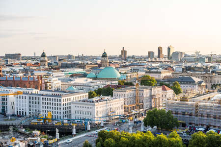 Cityscape of downtown of Berlin with modern skylines and church towers under sunset. Aerial view from Berlin Cathedral. Editoriali