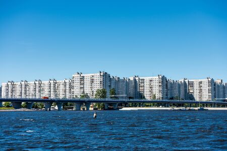 Modern apartments on the riverbank of Neva river in St. Petersburg, Russia.