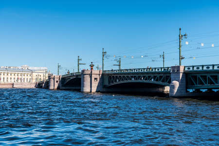 Palace Bridge  Dvortsovy bridge, a Hot Spot for locals and tourists, across the Neva River  in St. Petersburg. Russia