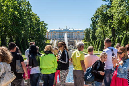 A lot of tourists watching the Samson fountain inside of the summer palace of peter the great in Saint Pertersburg, Russia.