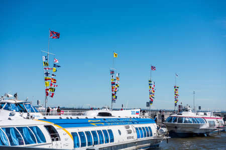 Colorful flags and cruise ship at the port of the summer palace of peter the great in Saint Pertersburg, Russia.