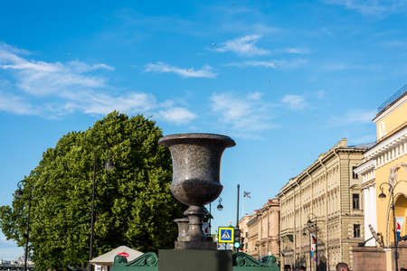 Granite vase in the street at the riverbank of Neva river in St. Petersburg, Russia