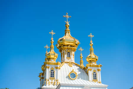 Golden domes of Peter and Paul Church in the Grand Peterhof Palace on a island of Saint Petersburg, Russia.