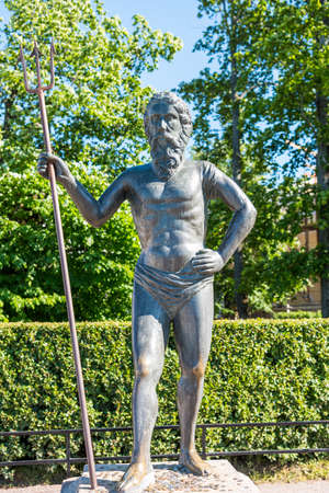 Statue of Poseidon in the  at the Peterhof gardens, the summer palce of the Peter the great in Saint Petersburg, Russia. Editöryel