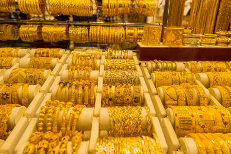 Golden jewelry at the gold street, also called Gold souk, in the city of Dubai, UAE