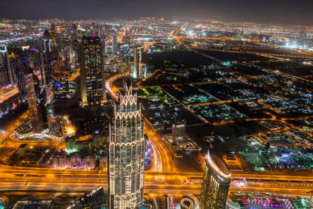 Night aerial view of Dubai from the top of Burj Khalifa Tower in Dubai, United Arab Emirates, the tallest building in the world.