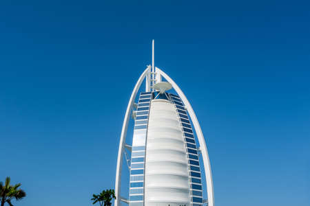Front view of the hotel of Burj Al Arab Jumeirah against blue sky, the world's most luxurious hotel
