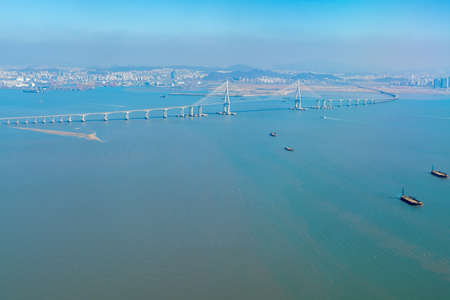 Aerial View of Incheon Bridge from a window of aeroplane, which is connecting mainland and airport island.