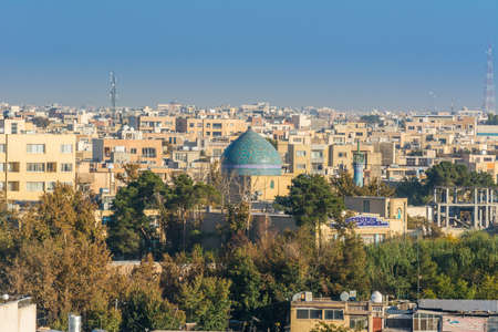 Aerial view of residential building skyline with blue tome of Lonban Mosque of Isfahan of Iran, one of the most famous historic city in the middle east. Sajtókép