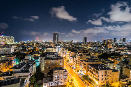 Night aerial view of Tel Aviv City with modern skylines and luxury hotels at the beach near the Tel Aviv port in Israel.