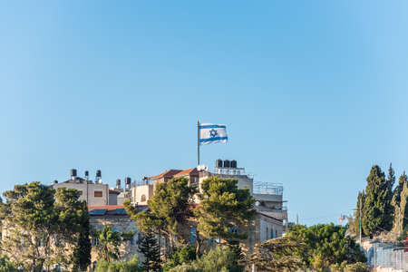 Israeli National flag waving on the top of rooftop in Mount of Olive in Jerusalem, Israel Standard-Bild