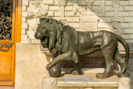 Bronze lion sculpture in front of Talar-e-Salam building of Golestan Palace inTehran, Iran, which is a UNESCO World Heritage site