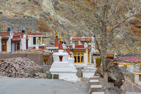 Tibetan traditional pagoda and village at the Hemis monastery with background of barren mountains in Leh, Ladakh, Jammu and Kashmir