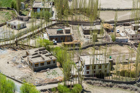Beautiful landscape at the river delta, Tibetian buildings and green trees in Ladakh, Kashmir, view from Thiksey Monastery or Thiksey Gompa.