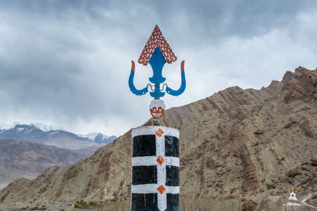 Tibetan traditional windmill and symbol of Hemis monastery with background of barren mountains in Leh, Ladakh, Indian Controlled Jammu and Kashmir Banco de Imagens