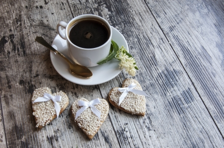 Cookies for the wedding with a cup of coffee served with a golden spoon  From the series  Wedding Cookies  photo