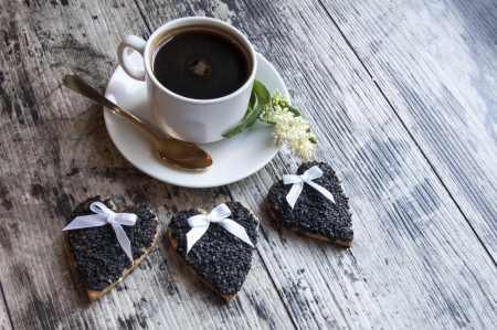 Cookies for the wedding decorated black sesame with a cup of coffee served with a golden spoon  From the series  Wedding Cookies  photo