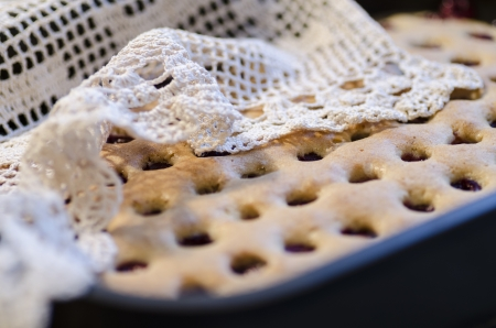 Homemade cherry pie with a knitted cloth. From the series Homemade Cherry Pie photo