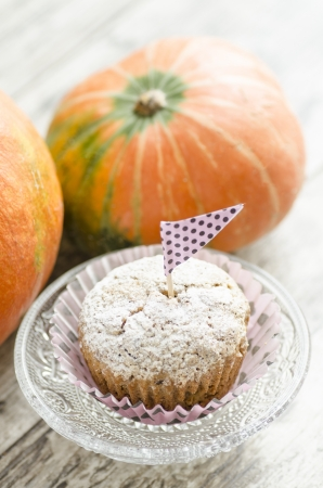 Pumpkin muffins on the table. From the series Pumpkin Cupcakes photo