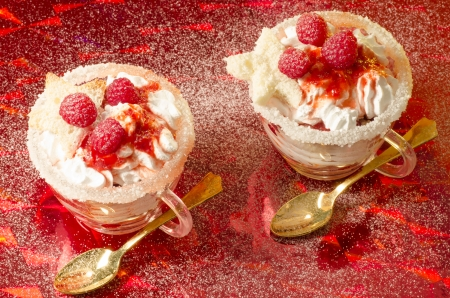 trifle: Christmas dessert in a glass with decoration. From series Cranberry-raspberry trifle Stock Photo