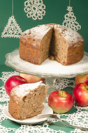 rum cake: Applesauce raisin rum cake for christmas table. Table decorated with lacy snowflakes and napkin. From series of Merry Christmas