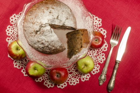 Applesauce raisin rum cake for christmas table. Table decorated with lacy napkin. From series of Merry Christmas photo